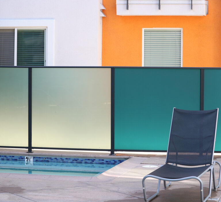 A set of two clear foggy windows and two turquoise colored tinted windows by a pool and beach chair.